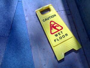 Yellow caution wet floor sign